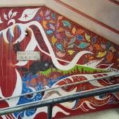 Japanese artist Shingo Katori's street art piece on the side wall of the Central-Mid-levels escalator.