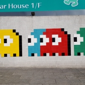 Invader's signature retro video game-style on Kowloon